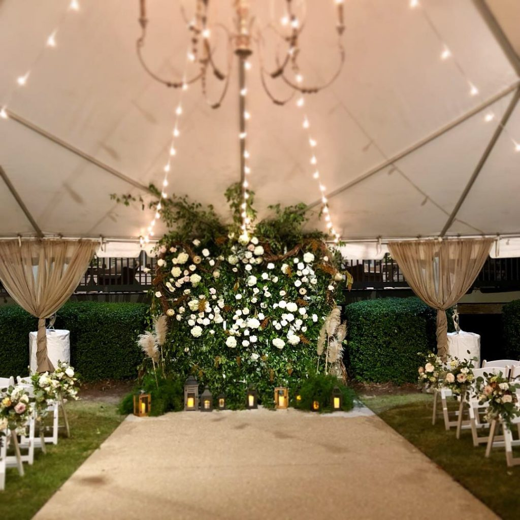 Wedding Ceremony Tent Wedding Chadelier Lush Greenery Neutral colors