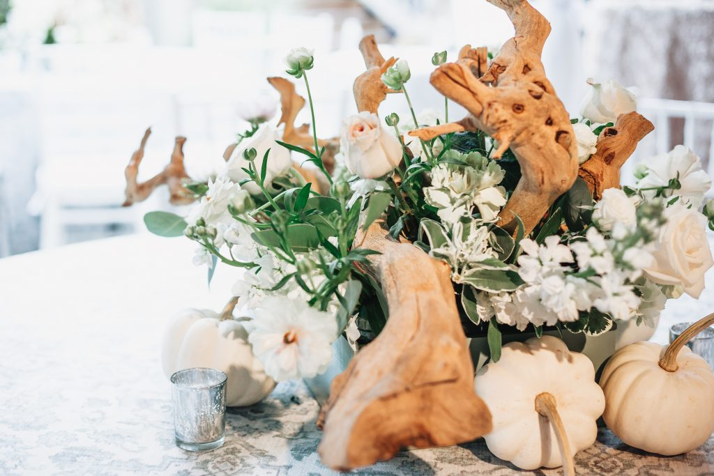 table centerpiece wood accents natural white flowers neutral wedding white pumpkins