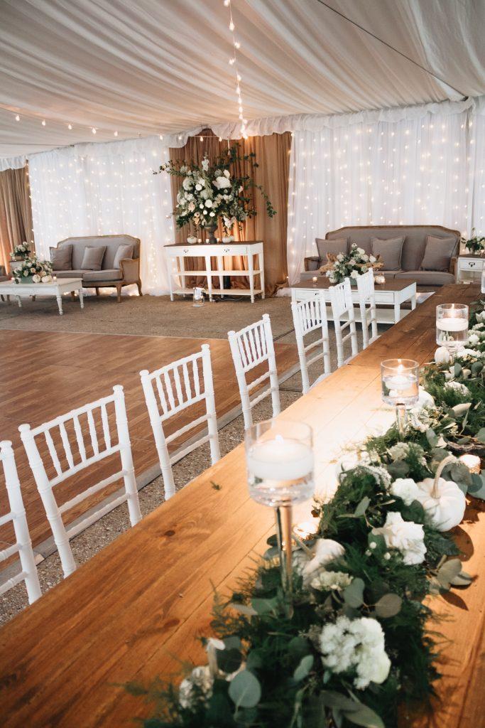 wedding reception tented garland white flower table centerpieces